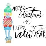 Fille d'aquarelle tenant le boîte-cadeau avec l'inspiration manuscrite Souhaitez-vous Joyeux un lettrage de Noël et de bonne anné Images libres de droits