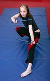Fille d'arts martiaux avec le sai Photographie stock