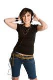 Fille d'écouteurs Image stock