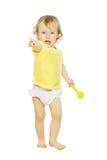 Fille d'enfant dirigeant la main de doigt en avant Blanc d'enfant d'isolement photo stock