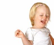 Fille d'enfant en bas âge riant à l'extérieur fort Image libre de droits