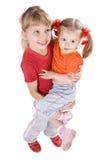 Fille d'enfants dans le T-shirt orange et rouge. photos stock
