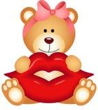 Fille d'ours de nounours tenant des lèvres Image stock