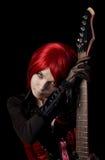 Fille d'une chevelure rouge sexy avec la guitare Images libres de droits