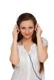 Fille dans des écouteurs Photo stock