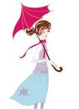 Fille dans des couleurs en pastel dans l'écharpe et un parapluie sous la pluie Image libre de droits