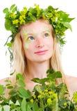 Fille dans des lames vertes Photo stock