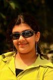 Fille dans des lunettes de soleil Images stock
