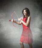 Fille dans l'amour avec l'arc de cupidon Photographie stock libre de droits