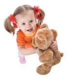Fille dans l'orange avec le jouet. photographie stock