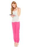 Fille dans la chemise et le pantalon avec la tablette Image stock
