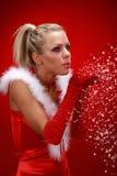 Fille dans la neige de soufflement de tissu de Santa Photographie stock