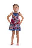 Fille dans la robe colorée sur le fond blanc Photo stock