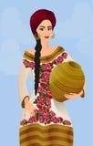 Fille dans la robe ethnique traditionnelle tenant une cruche image libre de droits