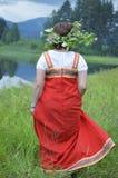 Fille dans la robe nationale Photographie stock