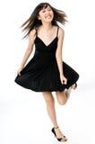 Fille dans la robe noire Photo stock