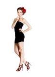 Fille dans la robe noire courte Photographie stock
