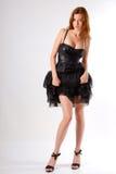 Fille dans la robe noire courte Images stock