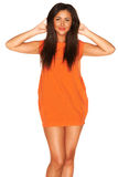 Fille dans la robe orange Photographie stock libre de droits