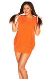 Fille dans la robe orange Images stock