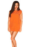 Fille dans la robe orange Image stock