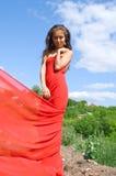 Fille dans la robe rouge Photographie stock
