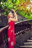Fille dans la robe rouge Photographie stock libre de droits