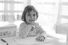 Fille dans la salle de classe Image stock