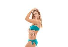 Fille dans le bikini sur le fond blanc Photo stock