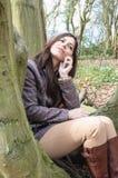 Fille dans le bois Photographie stock libre de droits