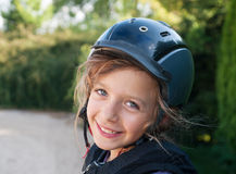 Fille dans le casque Photo stock