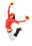 Fille dans le chandail orange d'automne avec le saut de lame. Images libres de droits