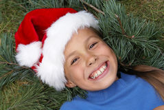 Fille dans le chapeau 2 de Santa Images libres de droits