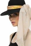 Fille dans le chapeau avec l'écharpe Photos stock