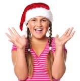 fille dans le chapeau de Santa Photographie stock