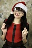 fille dans le chapeau de Santa Image libre de droits