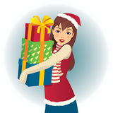 Fille dans le chapeau de Santa avec des cadeaux à disposition Photographie stock libre de droits