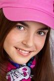 Fille dans le chapeau rose Photo stock