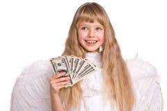 Fille dans le costume d'ange avec de l'argent du dollar. Image libre de droits