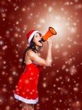 fille dans le costume de Santa Claus avec un mégaphone Images libres de droits