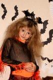 Fille dans le costume de sorcière Photos stock