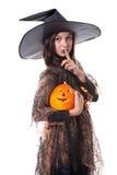 Fille dans le costume de veille de la toussaint retenant un potiron Photos libres de droits