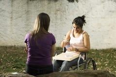 Fille dans le fauteuil roulant Images libres de droits