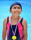 Fille dans le maillot de bain avec des médailles Photographie stock libre de droits
