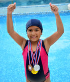 Fille dans le maillot de bain avec des médailles Photographie stock