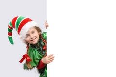 Fille dans le procès de l'elfe de Noël Photographie stock