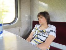 Fille dans le train Photos stock