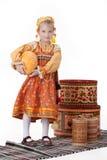 Fille dans le vêtement traditionnel russe image stock
