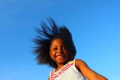 Fille dans le vent Photo stock