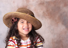 Fille dans un chapeau Photos stock